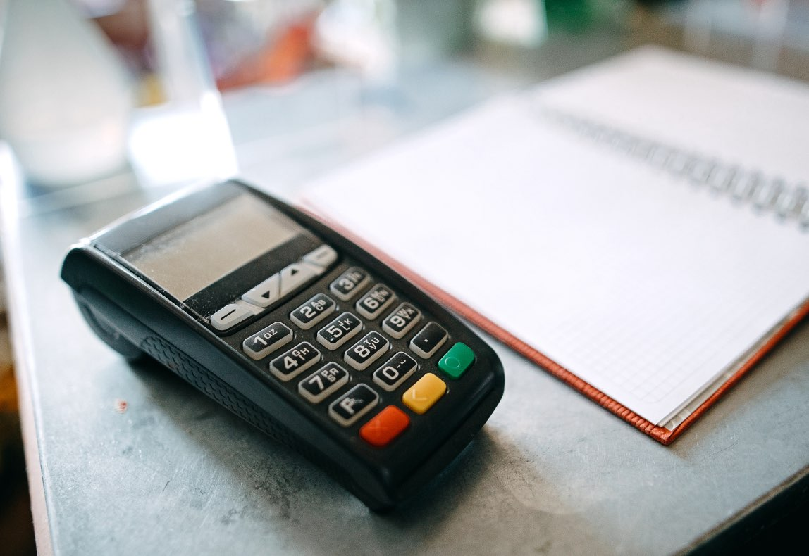 Credit card scanner on table