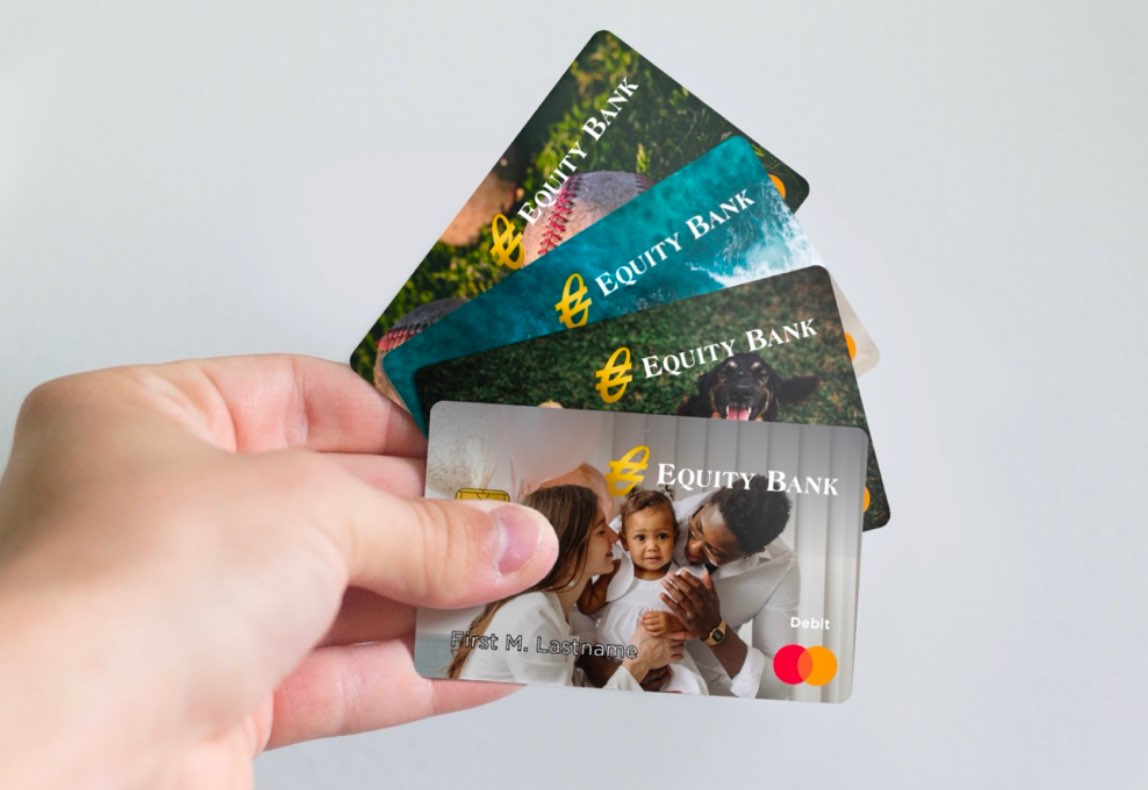 Close-up of four personalized debit cards
