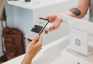 person using Equity card with Google Pay