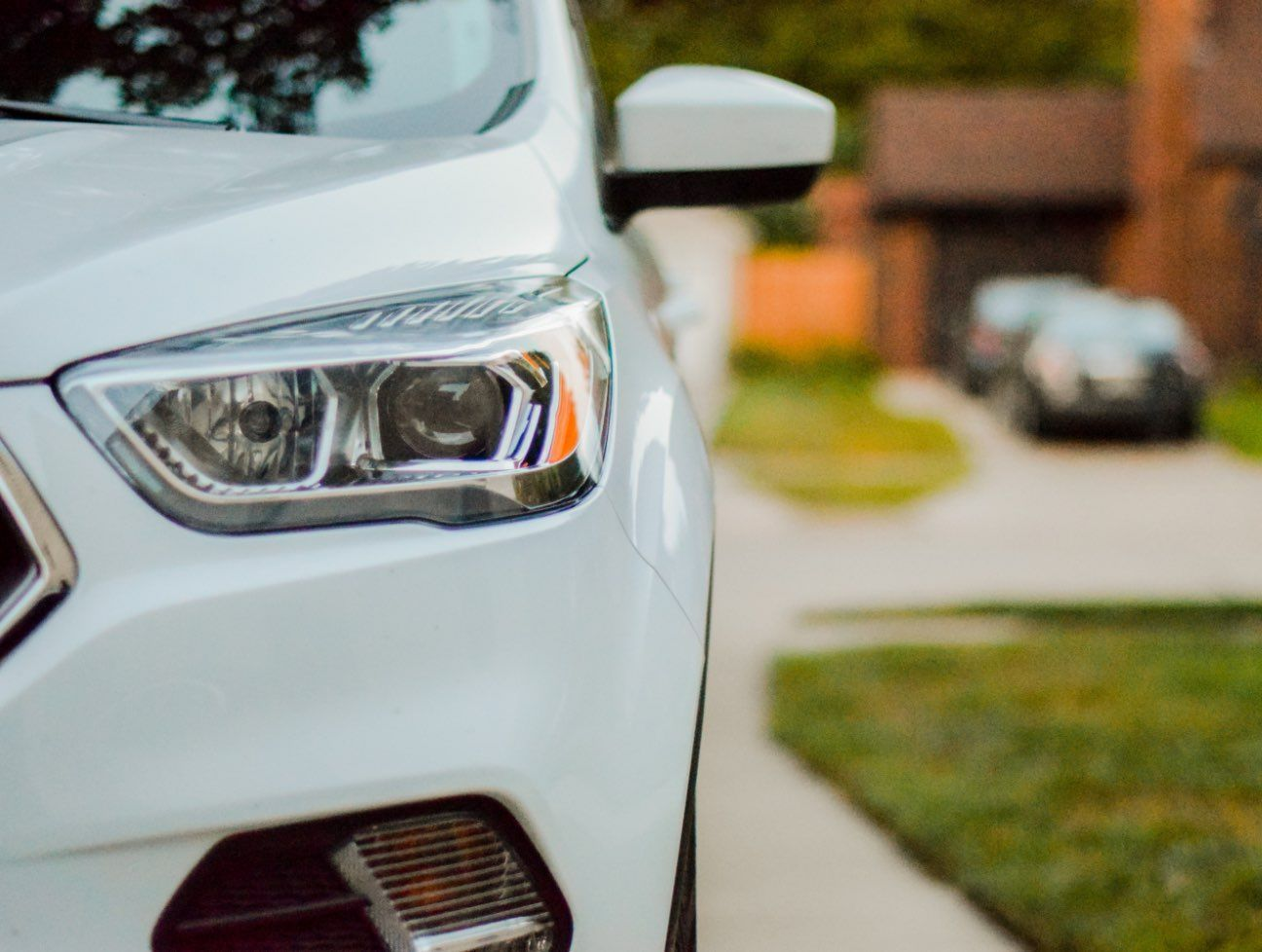 Close up of car front and headlight.